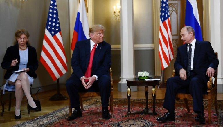 В честь встречи Путин — Трамп выпустили монету, в надписях на русском — ошибки