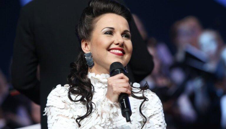 Foto: Ķīpsalā izskanējuši krāšņie Rīgas Ziemassvētku koncerti