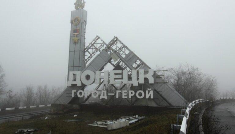 Меркель, Путин и Макрон обсудили урегулирование конфликта в Донбассе