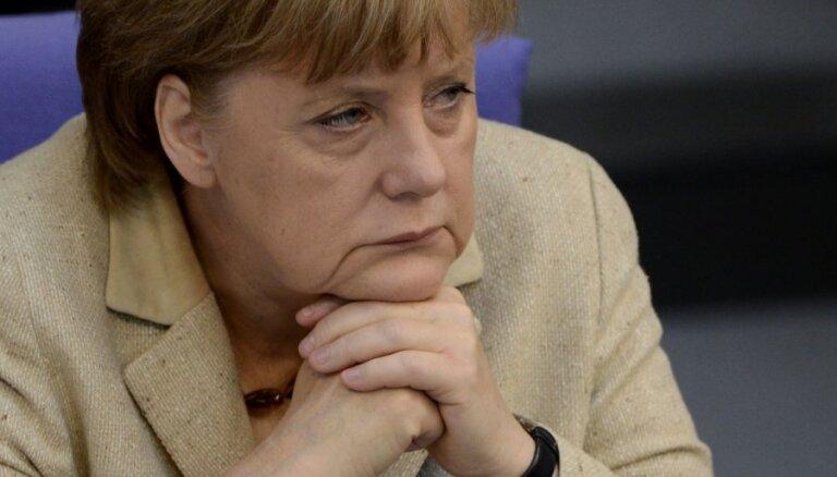 Лидеры Германии и Италии поклялись друг другу спасти еврозону