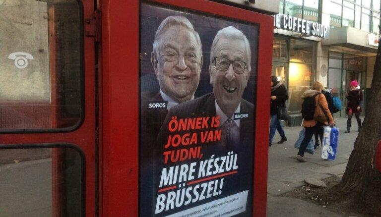 Ungārija jaunā mediju kampaņā uzbrūk Sorosam un Junkeram