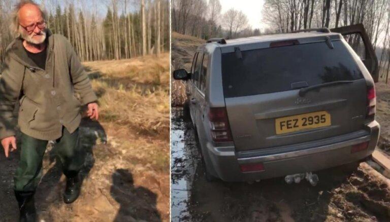 Video: Tēvs pamatīgi izlamā dēlu par iestigšanu purvā ar džipu