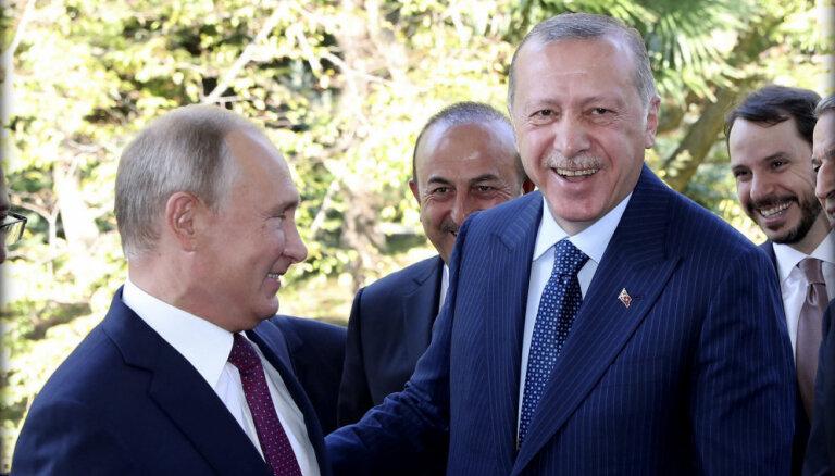 Почему Эрдогана принимают в Берлине по высшему разряду, а Путина— нет
