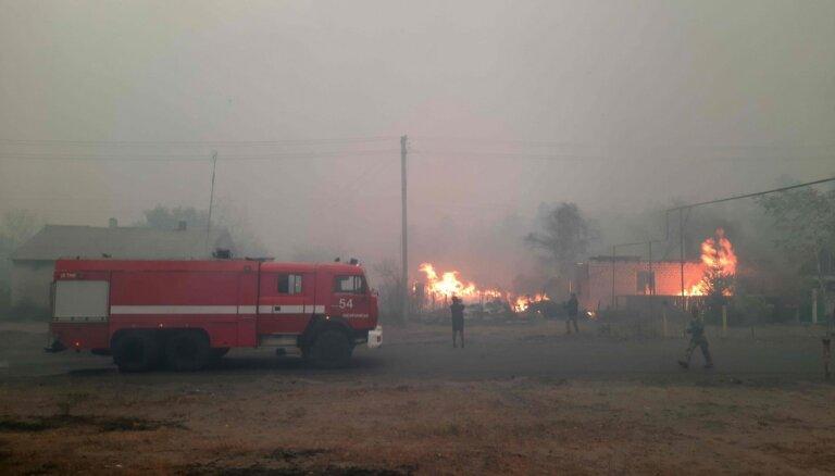 Luhanskas apgabalā deg meži; cieš arī mājas un ciemi